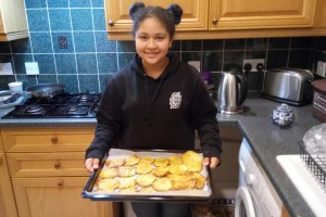 Nuria holding sweetcorn fritters