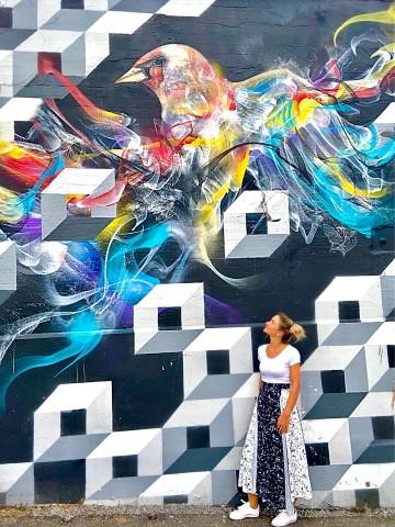 Student Roxana with colourful graffiti